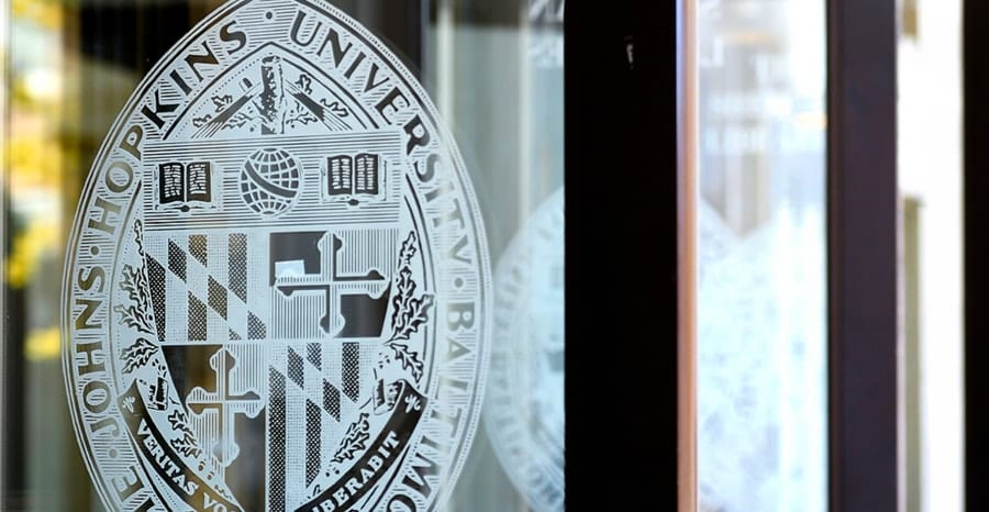 Johns Hopkins seal on open library doors