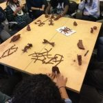 Students modeling with clay