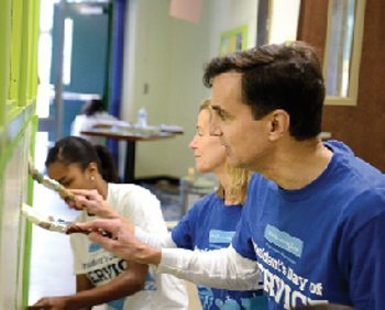 President Ron Daniels and his wife, Joanne Rosen, help spruce up the 29th Street Community Center
