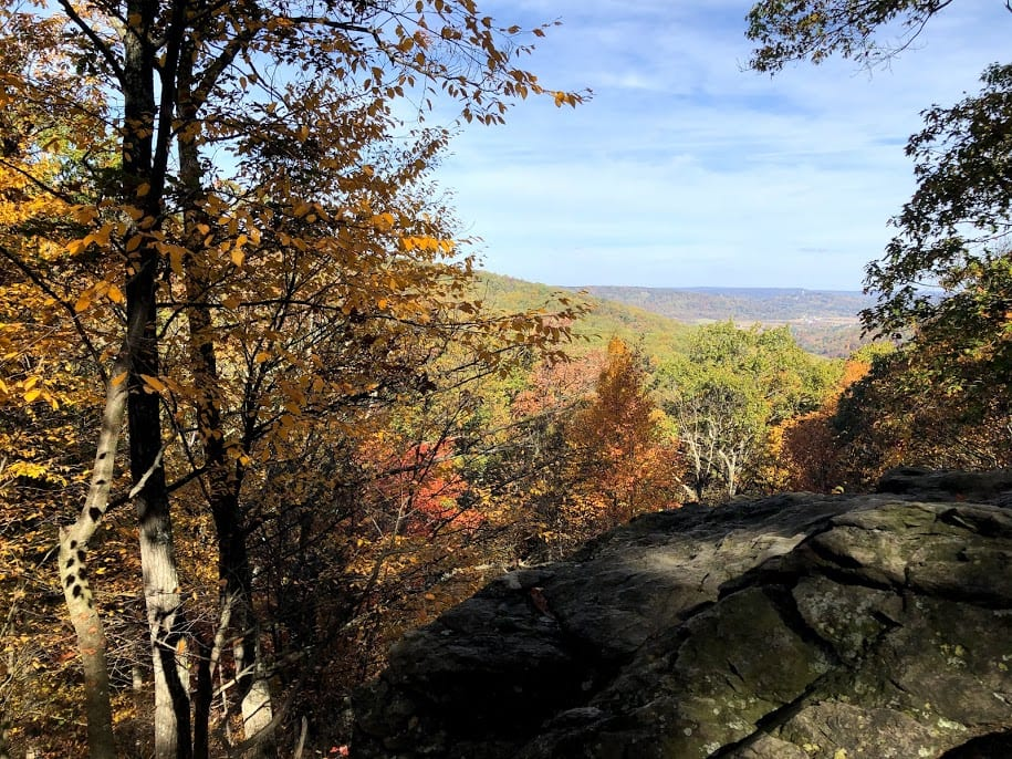 Rocky overlook through trees with red and yellow leaves
