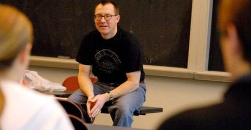faculty wilson in t-shirt, lecture, in front of two students